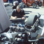 Robert Perry in motorbike drawing mode. The paddock. Isle of Man TT Races 2000. Photo