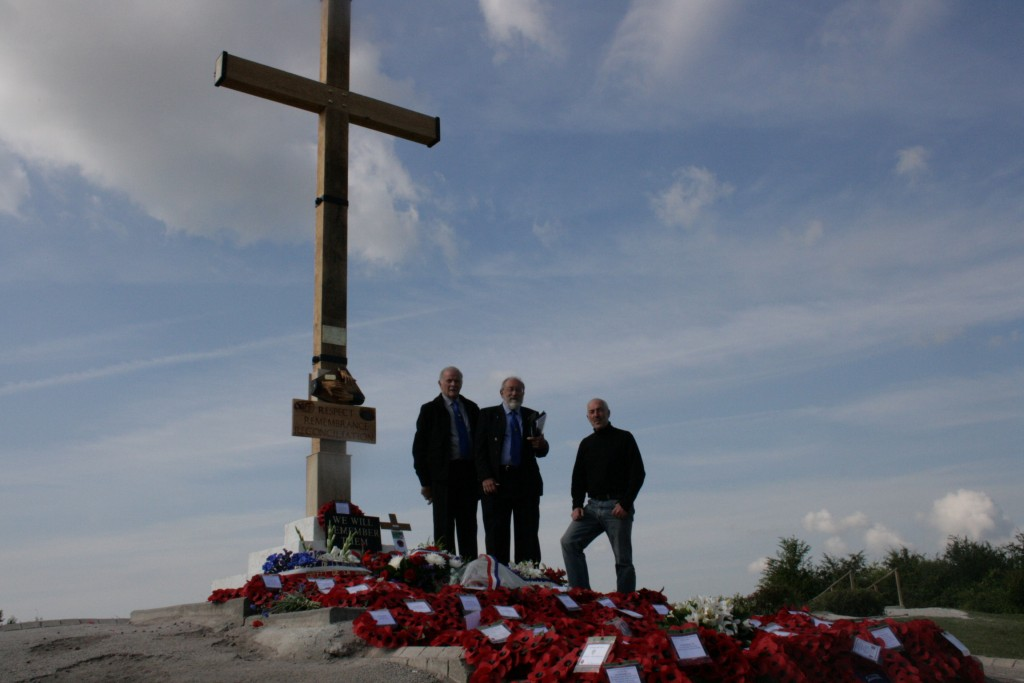 The rim of the Lochnagar Crater with the new Great Cross of Remembrance. Left to right: Vin Felstead who conceived, organized and constructed the Cross, Richard Dunning who owns and preserves the site, Rob Perry.