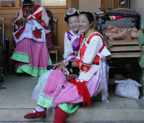 Naxi girls preparing for traditional dance 18 October 2012