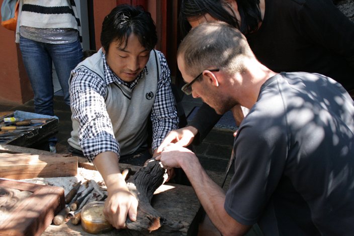 Andras has a first lesson in woodcarving  from Xiao Dongba.