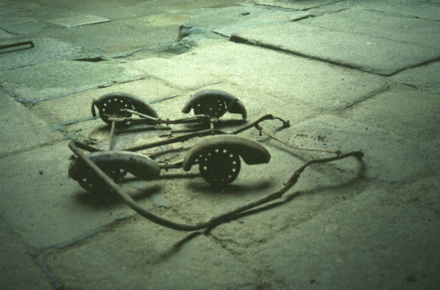 Orad97Ph-07 Burned remains of a child's pushchair in the church Photograph 1997