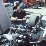 Robert Perry in motorbike drawing mode. The paddock. Isle of Man TT Races 2000. Photo