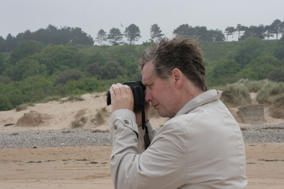 2.35pm, 5 June 2013. Paul Middleton photographing on Omaha Beach.